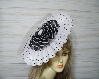 Pink with an array of dried pearl like flowers and netting Tight fitting with elastic Retro 80s90s fascinator hat Made in Canada