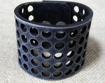 Leather cuff with holes