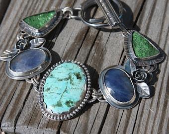 turquoise, sapphire, uvarovite garnet druzy,  and sterling silver metalwork link bracelet
