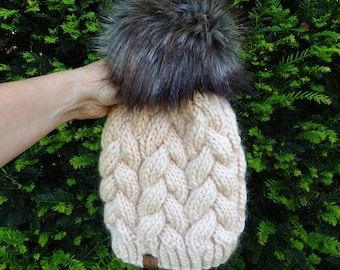 The softest hand knitted chunky 100% merino braided cable hat with super-sized faux fur pom pom