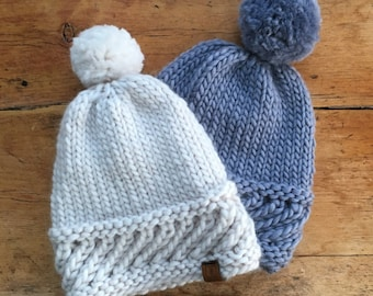 The softest hand knitted 100% merino beanie/pom pom hat with a textured band