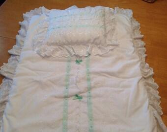 Bassinet quilt and pillow set.