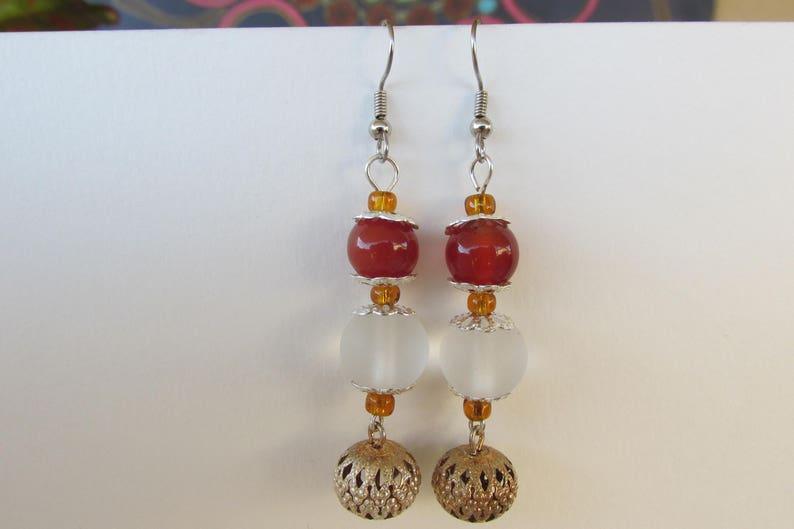 Orange and silver ball dangle earrings