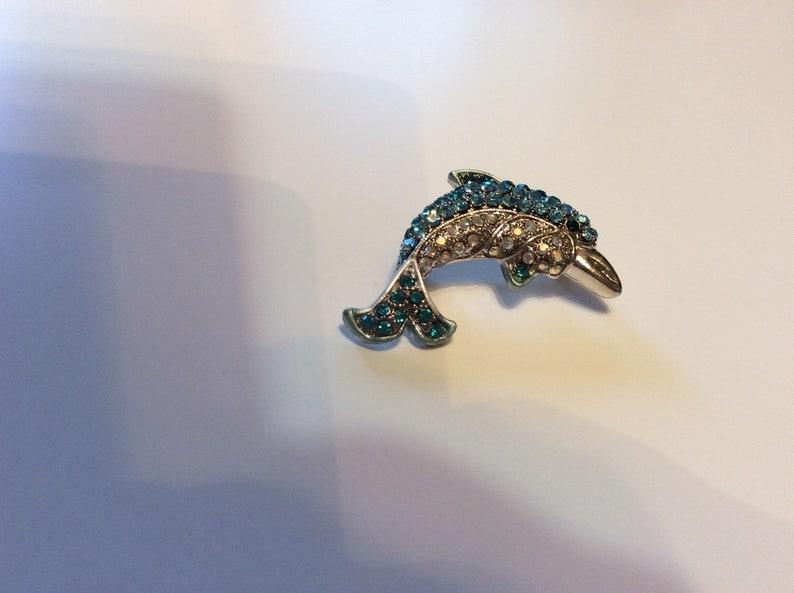 Rhinestone dolphin brooch