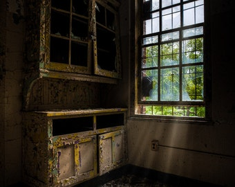 dark empty cabinets - abandoned asylum, fine art print of a window shining light on dark empty cabinets in an abandoned building, signed.