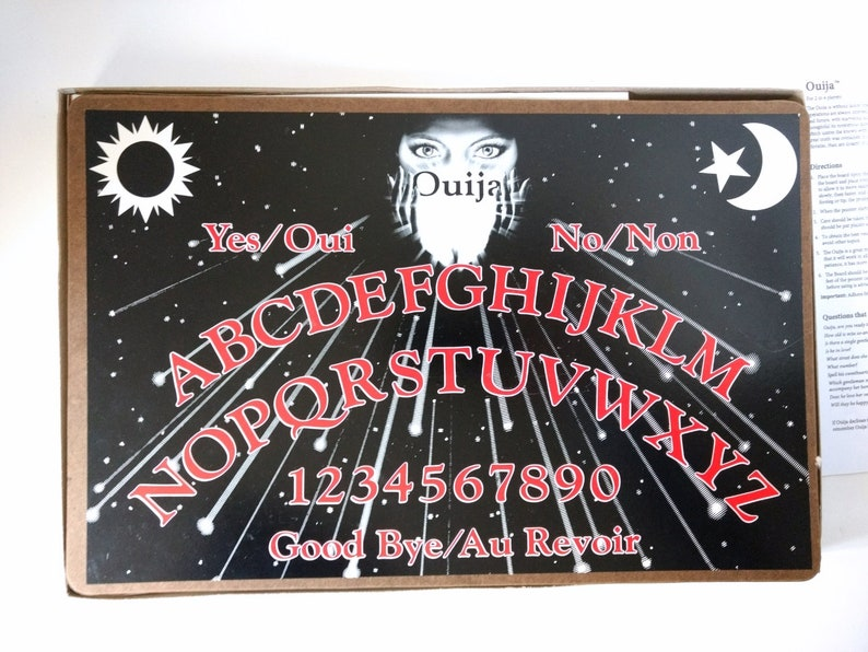 Ouija Board and Planchette, rules and boxed, black red and white shooting  starry night space scene Vintage 1991 boxed Canada Games