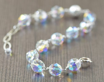 Shimmering Swarovski crystal bracelet. Wire wrapped in sterling silver, 7 inches, adjustable to 8 inches