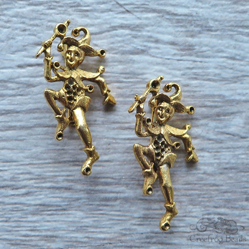 2 Brassy gold toned metal brooch pin components with harlequin motif Vintage jewelry findings with pin back and spaces to set rhinestones.