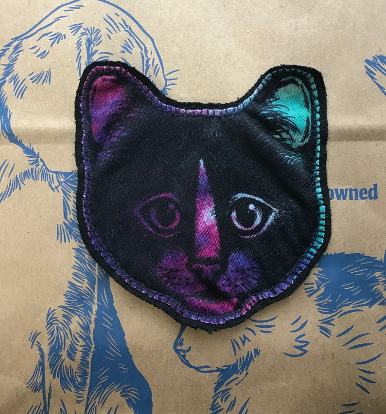Sewn on black backing with navy thread. Plain cat face patch CAT face patch Black cat graphic on purplepinkteal fabric