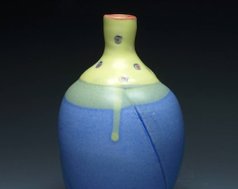 Yellow and Blue dotted Handmade Ceramic Bottle With Red and Blue Highlights