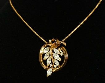 TRIFARI Gold Metal Vintage Pendant with Clear Rhinestones in Leaf Motif on Gold Metal Chain