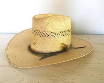 6a5d4df45cc bailey hard straw hat - u rollit cowboy or cowgirl western hat - distressed  and worn with feathers stuck in the band - small size 6 3 4