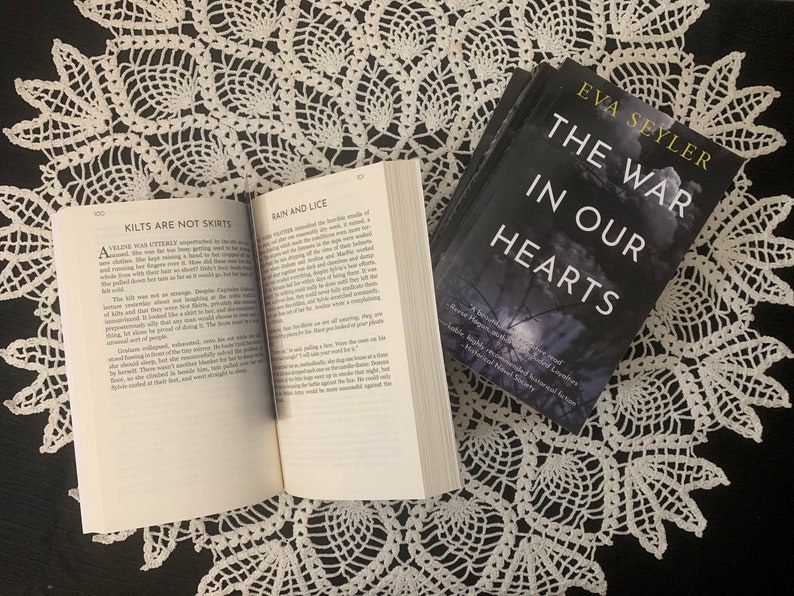 The War in Our Hearts: Signed Paperback Copies of Eva Seylers image 0