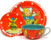50 39 s Tin Toy Tea Setting, Cup plates with Dutch ice skater and ducky.
