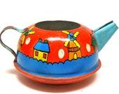1940s Tin Toy Tea Pot. Wind mills. Made by Ohio Art. Dutch Winter Wonderland.