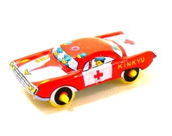 Mini 1960s Tin Toy car. Vintage red emergency vehicle, KINKYU. Made in Japan.