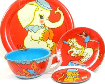 1950's tin toy tea set with Circus design by Ohio Art Co. 4 pieces, cup, plate, saucer & bread plate.
