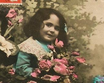 1900s French postcard. Edwardian child with flowers. RPPC real photo postcard, paper ephemera. vintage carte postale