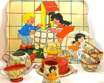 1940's tin toy tea set with Ducky Bath Time. Litho by Ohio Art Co. 22 piece set.
