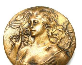"""Antique Art Nouveau BUTTON, French brass with lovely woman holding a rose, 3/4""""."""