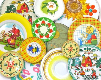 13 Tin Toy tea saucers in yellows, 1960s graphics, Instant Collection. Ohio Art Co. Vintage Decor.