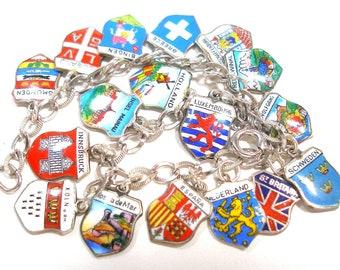 "Travel Charm bracelet, Sterling silver with 17 enamel shields, 7"". Fully loaded."