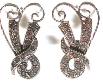 1920s antique silver earrings. Bow with rhinestones & screw backs. Sterling silver.