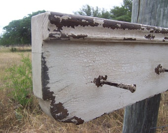 Shabby chic primitive shelf painted in an antique white shelves for a rustic farmhouse decor