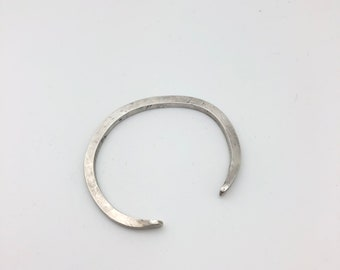 Word phrase cuff, sterling silver . Straight (without a twist.) Hardy and elegant.