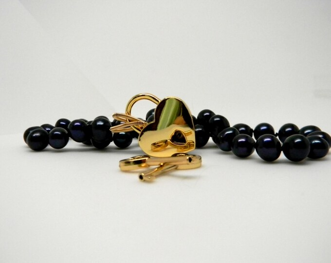 Featured listing image: Discreet Slave Collar Black Iridescent Freshwater Potato Pearls 9-10mm  Hand Knotted Silk with 14kt gold fill ends & Gold Tone Heart Lock