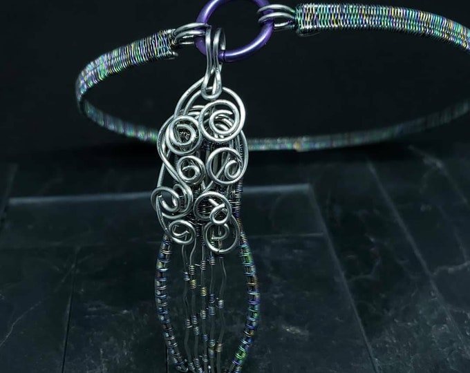 Featured listing image: 14 Inch Discreet Slave Collar Hand Woven Rainbow Anodized Niobium & Stainless Steel Wire with Purple Titanium Captive Segment Clasp