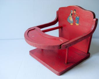 Vintage high chair with charming illustration