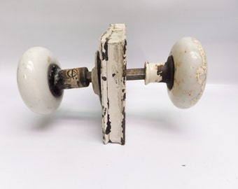 Antique porcelain and metal doorknob set