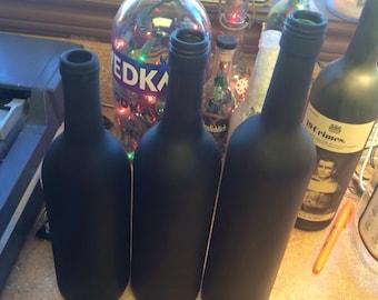 Three Chalkboard painted wine bottles!
