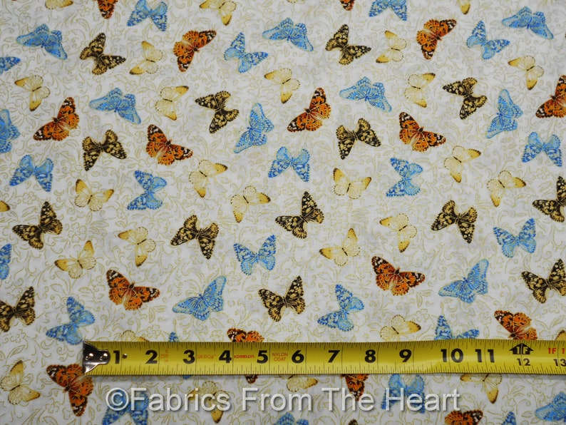Butterflys Field of Dreams Gold Metallic on Cream BY YARD image 0
