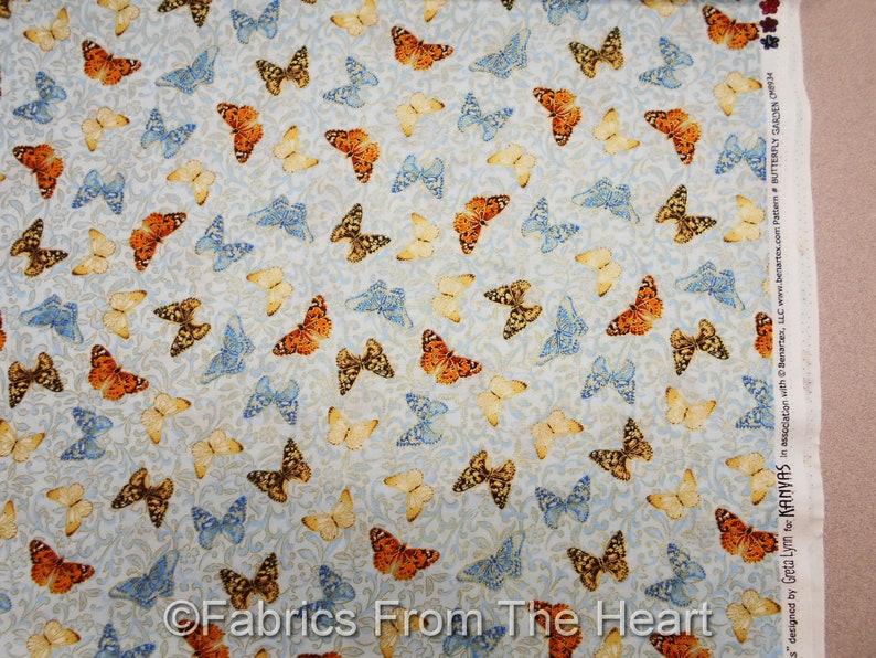 Butterflys Field of Dreams Gold Metallic on Blue BY YARD image 0