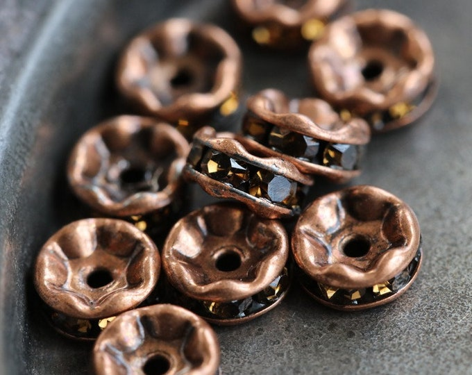 last ones .. 11 x 6mm Antique Copper Czech Smokey Topaz Rhinestone Rondelles (rhi-05/11)