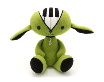 Piano doll, musical soft toy