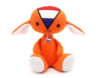 Orange doll with Dutch national flag, national holiday celebration, heirloom toy