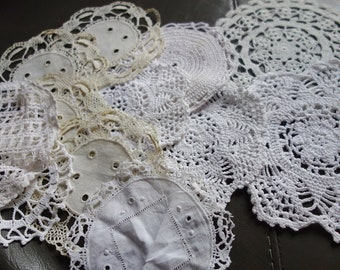 12 small lace doilies