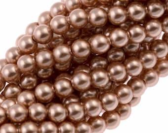 6mm Rose Gold Pearl 5810, Swarovski® crystals, Rose Gold, 6mm round (5810). Sold per pkg of 48