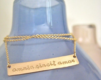 """Gold Bar Necklace Inspiring Quote- """"Love Conquers All"""""""