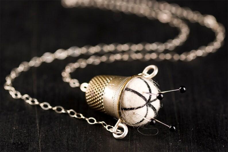 Handmade Off White with Black Stitching Pincushion Necklace image 0