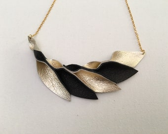 Petal Collection:   Black and Gold Petals leather Necklace