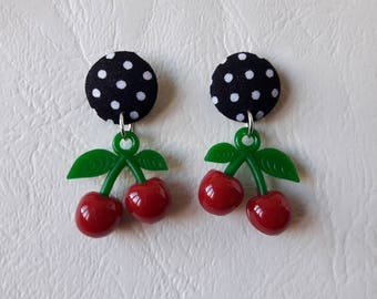 Black round earrings with white polka dots and cherry red