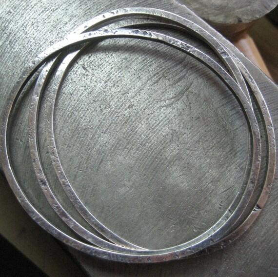Three Organic Sterling Silver Bangles