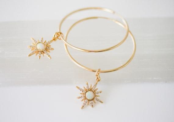 Gold Hoop Earrings with Starburst Charm