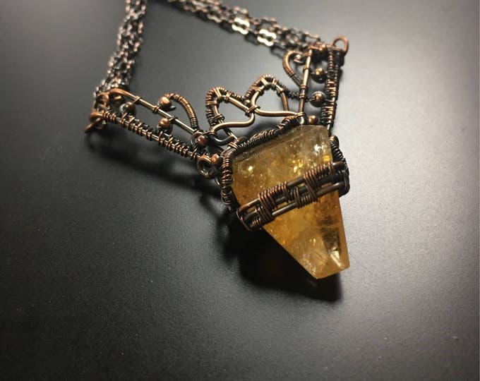 Natural Citrine stone woven in copper wire