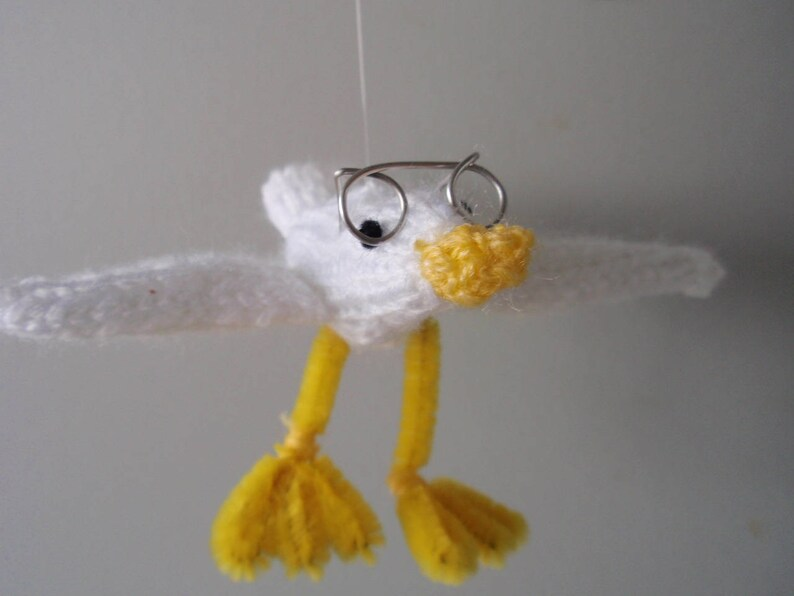 Hand knitted baby seagull with silver wire spectacles