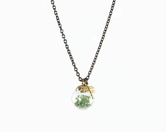 Small glass globe filled with green crystal. Tiny Brass Dragonfly  Globe Necklace